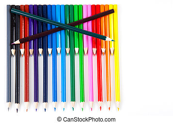 Row of color pencils on white background