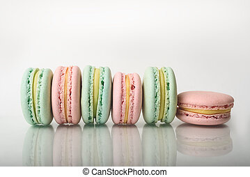 Row of colorful macarons on the natural background.