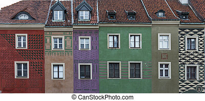 Row of colorful old houses in the historical town square of Poznan, Poland - panoramic composition