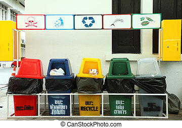 Row of colorful recycle bins