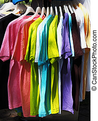 row of colorful shirt rack on clothes hanger
