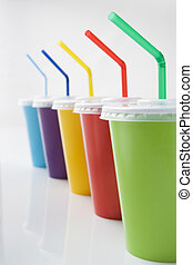 Row Of Coloured Soft Drink Beakers With Straws