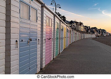 Row of colourful beach huts on Lyme Regis seafront