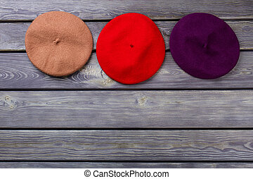 Row of colourful berete hats.