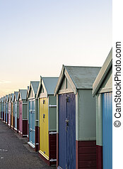 Row of colourful wooden beach huts