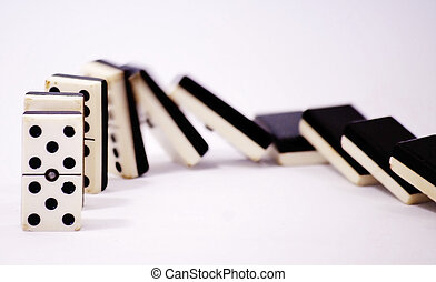 Row of dominoes falling over white background