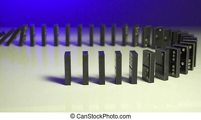 Row of dominoes with one falling over on blue background