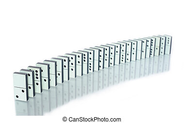 Row of dominoes with reflection on white