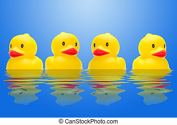 Row Of Ducks - Yellow Plastic Bath Toy Ducks In A Row With A...