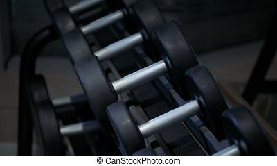 row of dumbbells in the gym, camera stabilizer shot