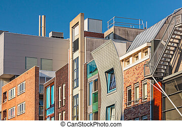 Row of Dutch contemporary canal houses in Amsterdam
