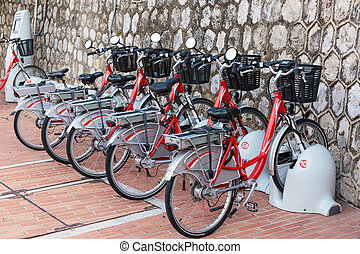 Row of electric bicycles in the parking lot