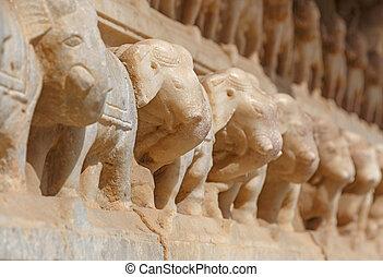 row of elephants carved on wall