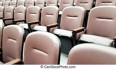row of empty chairs, seats in lecture hall
