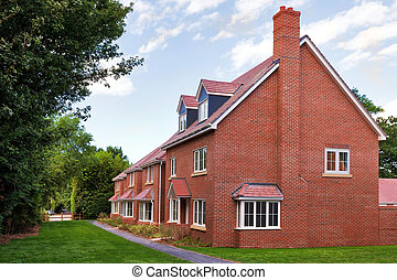 Row of empty new houses - A row of empty new red brick ...