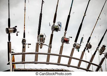 row of fishing rods on ship - Closeup photo of row of...