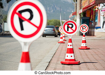 Row of five No parking signs located on a roadside