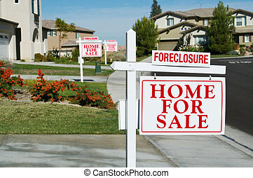 Row of Foreclosure Home For Sale Real Estate Signs in Front...
