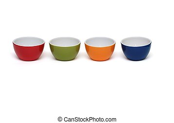 Row of four porcelain bowls isolated on white background