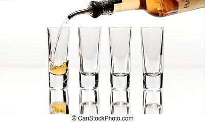 Row of Four Shot Glasses Lined Up - Four double shot glasses...