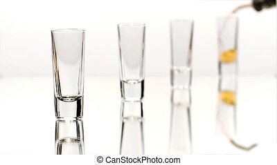 Row of Four Shot Glasses - Four double shot glasses are...