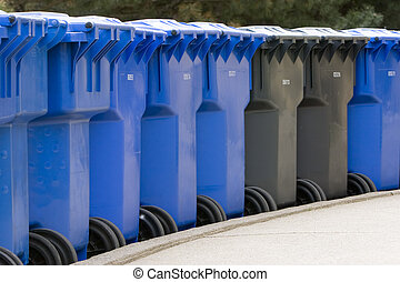 row of plastic garbage cans