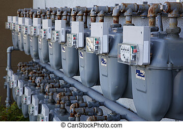 Row of gas meters - Two Rows of gray gas meters at an ...