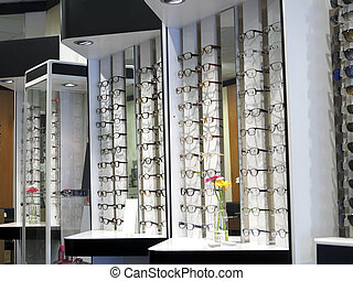 Row of glasses at an opticians - Display in store with ...
