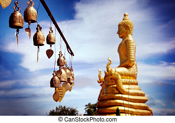 Row of golden bells in buddhist temple. big buddha in Thailand. Travel to Asia,