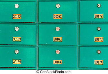 row of green mailboxes