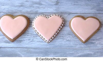 Row of heart shaped biscuits. Delicious decorated cookies on...
