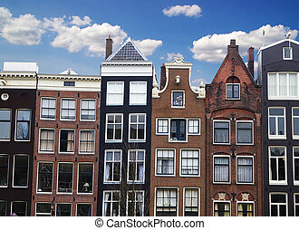 Row of houses and buildings along a canal in Amsterdam, the Netherlands
