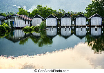 Row of houses on the river with reflections in the water