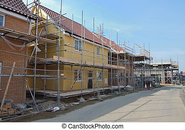 row of houses under construction - row of new houses under ...