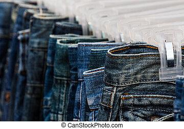 Row of Jeans and trousers . - Row of Jeans and trousers on...