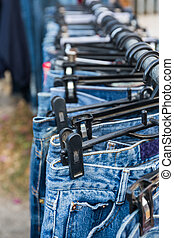 Row of Jeans and trousers.