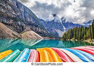 Row of Kayaks on Moraine Lake in the Canadian Rockies
