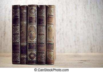 vintage books - Row of leather vintage books on shelf