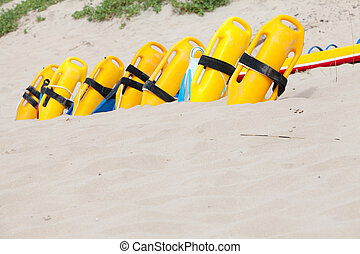Row of lifesaving floatation devices on the beach