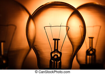 Row of light bulbs on a bright amber background with detail