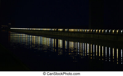 Row Of Lights On River - Long row of lights reflected on a ...