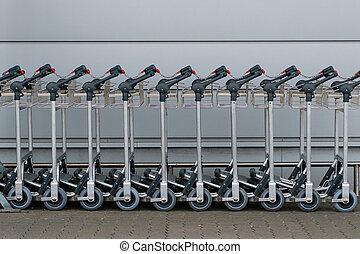 Row of luggage carts / baggage cars at airport -