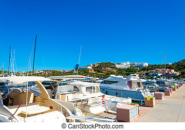 Row of luxury yachts in Porto Cervo harbor