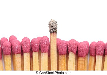 Row of matches, one standing out
