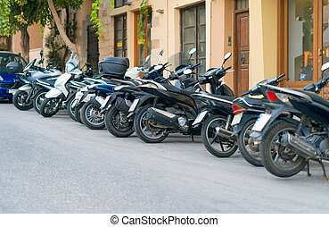 Row of motorcycles on the parking lot.