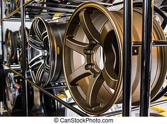 Row of new car alloy rim. - Row of new car alloy rim on...