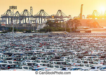 Row of new cars in port.