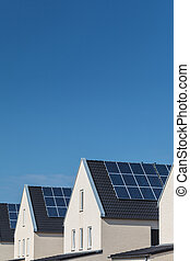 Row of new houses with solar panels on the roofs - Row of...