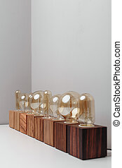 Row of old-fashioned steampunk style lamps on variety of wooden bases