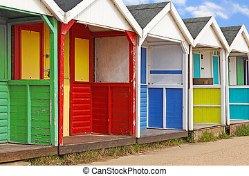 Row of old wooden beach huts